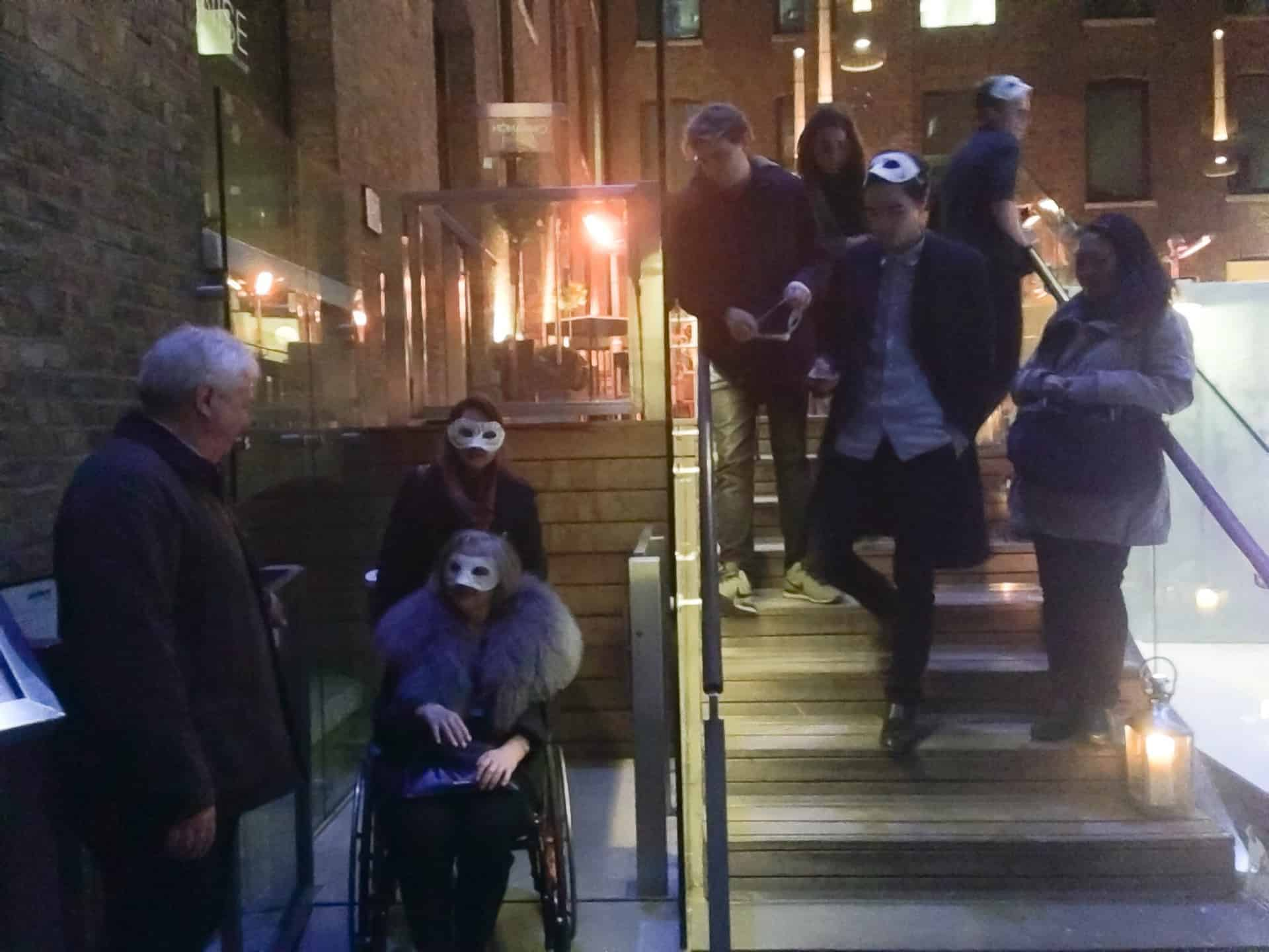 Everyone Looks on As If They've Never Seen a Masked Woman Use a Wheelchair lift Before
