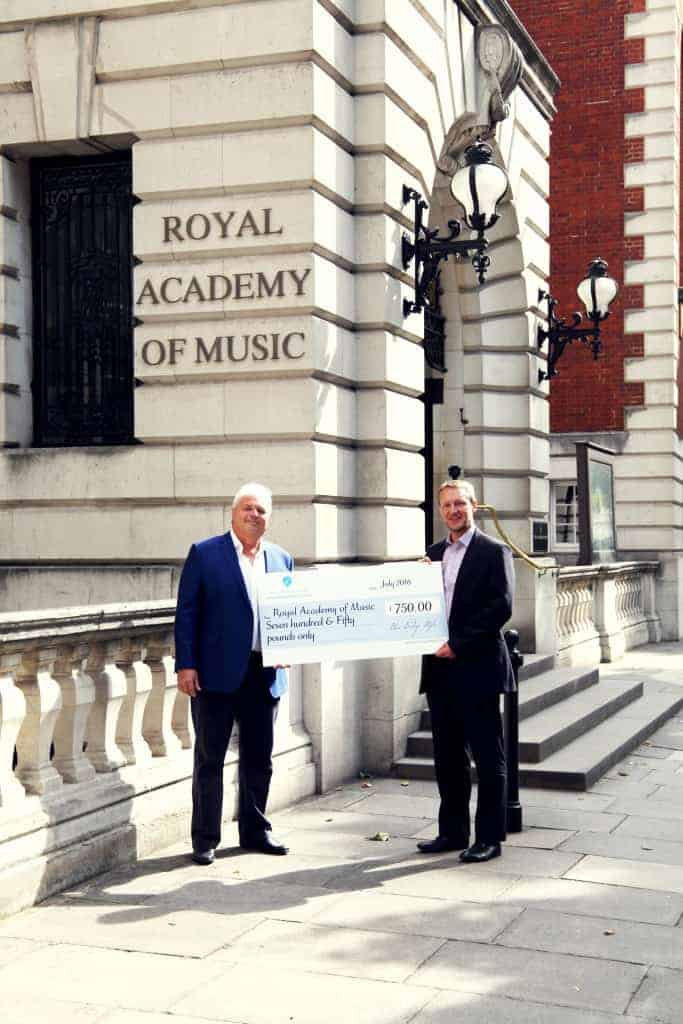 Paul Mounsey, Dir. of BBS Presents V. Large Cheque to Robert Carter at The RAM. BBS MIX Concert 2016, Again produced a Bursary for Musicians With Disabilities.