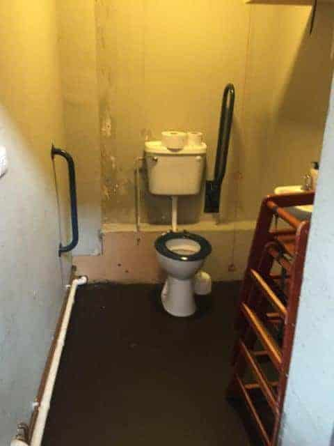 Typical Disabled Toilet Full of Chairs & Dirty