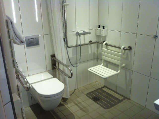 Scandic Copenhagen Adapted Bathroom With All The Rails and a Wall Mounted Shower Seat