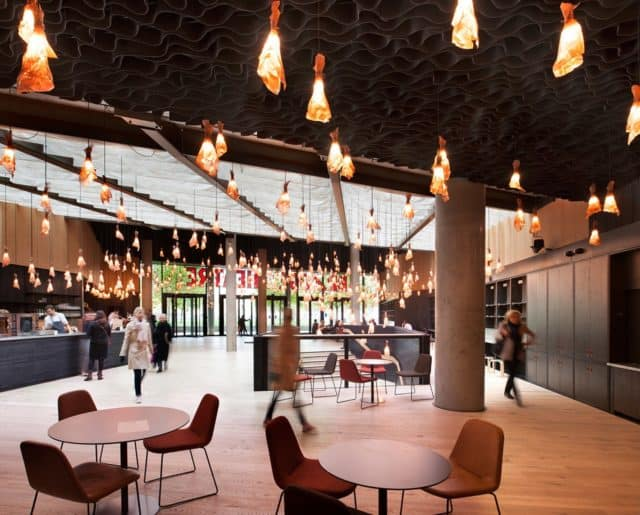 Brightly lit cafe space at The Bridge Theatre features flat access and food from St. John