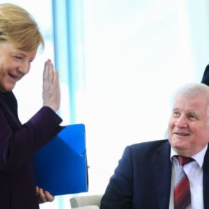 The German Chancellor went in for a handshake, then opted for a wave instead of a handshake