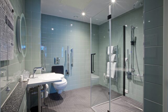 Accessible BAthroom at The Telegraph Hotel Coventry. Walk In Shower & Grab Rails Around the Toilet
